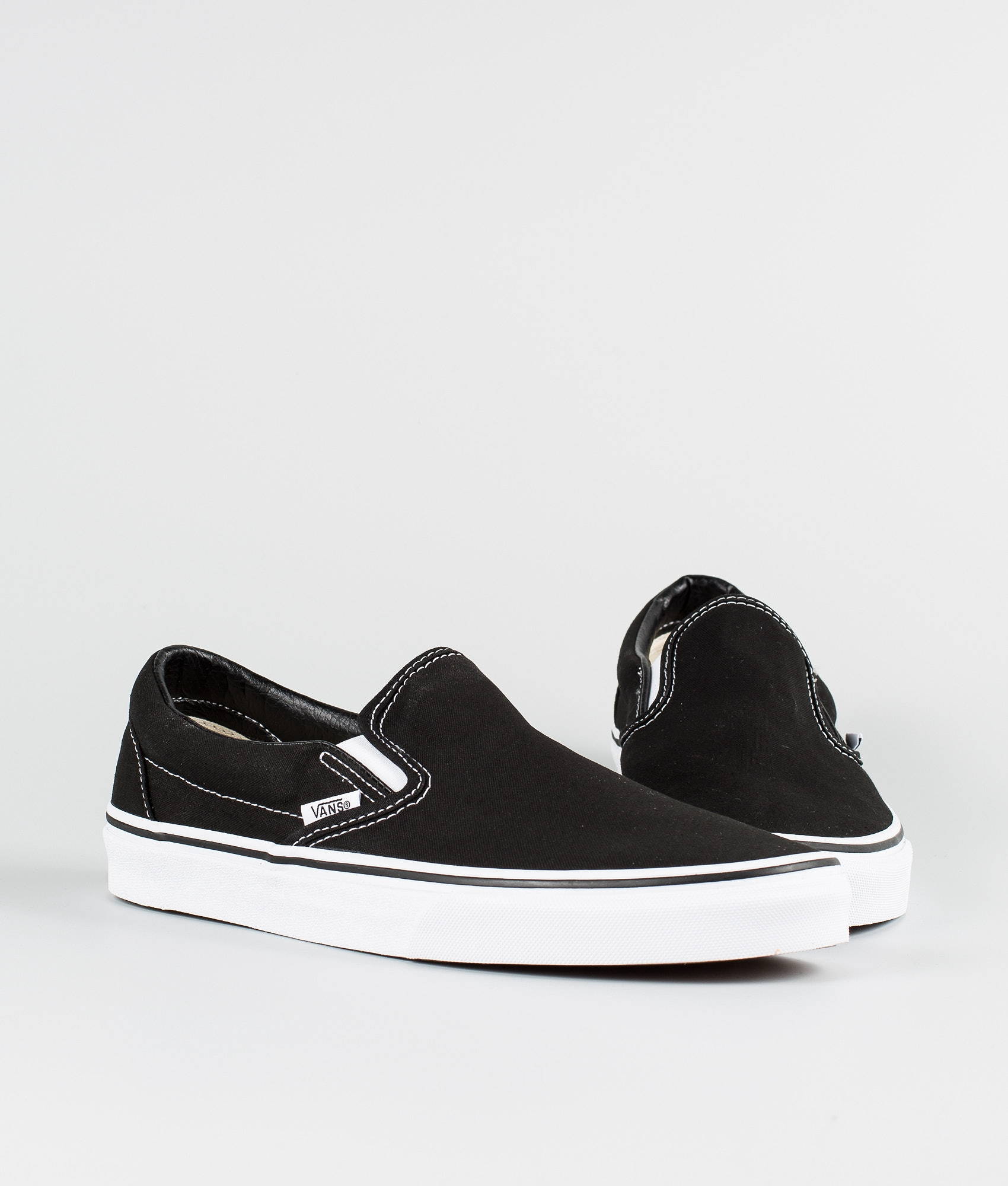 d9ae9bddfcef Vans Classic Slip-On Shoes Black - Ridestore.com